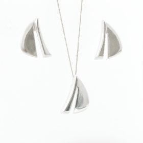 Silver Pendant And Silver Earrings